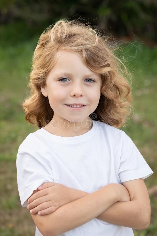 Funny blond kid with long hair royalty free stock photo