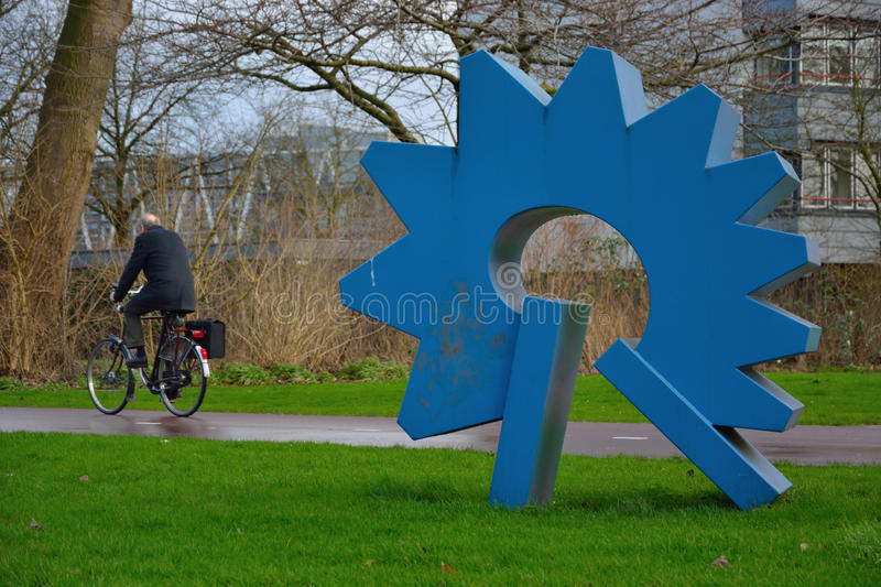 Funny blue metal contemporary statue in a dutch park stock images
