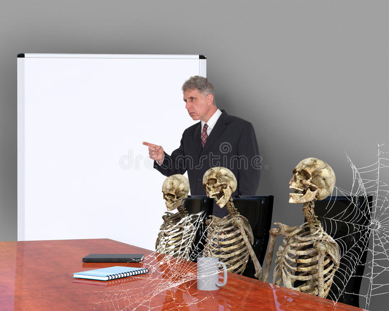 Funny Bored Meeting, Sales, Business. Funny board meeting as in BORED. The business team has died of boredom as the boss rants on with a never ending meeting royalty free stock photography
