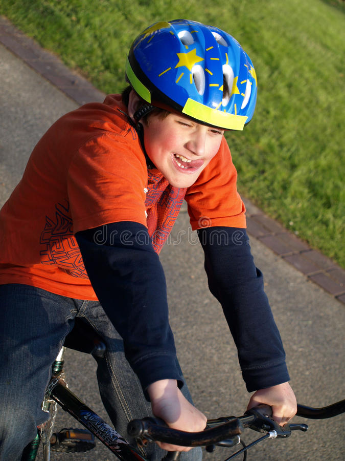 Download Funny Boy On The Bike With Helmet Stock Image - Image: 19492715