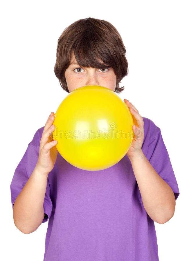Funny Boy Blowing Up A Yellow Balloon Stock Image