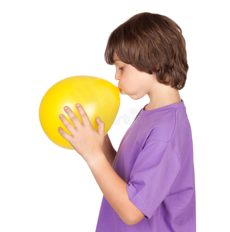 Download Funny Boy Blowing Up A Yellow Balloon Stock Image - Image: 14800041