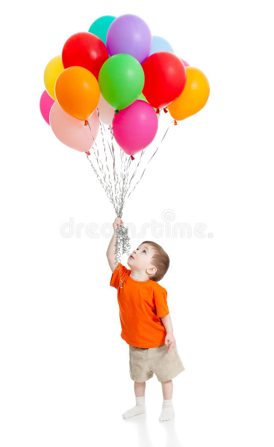 Funny boy with bunch of colorful ballons in hand