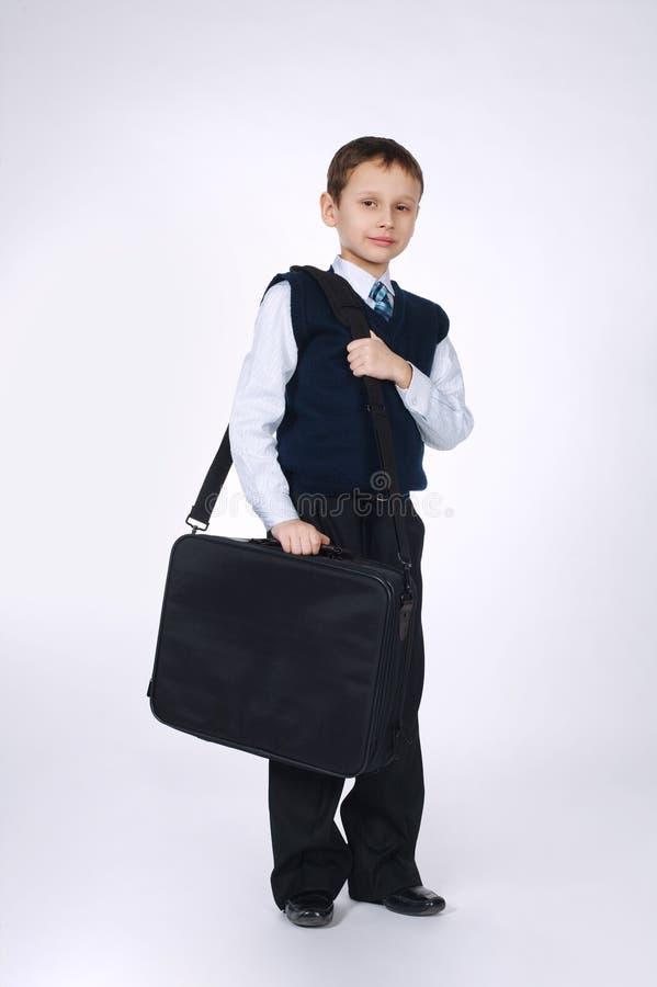 Funny boy with case on white stock photos