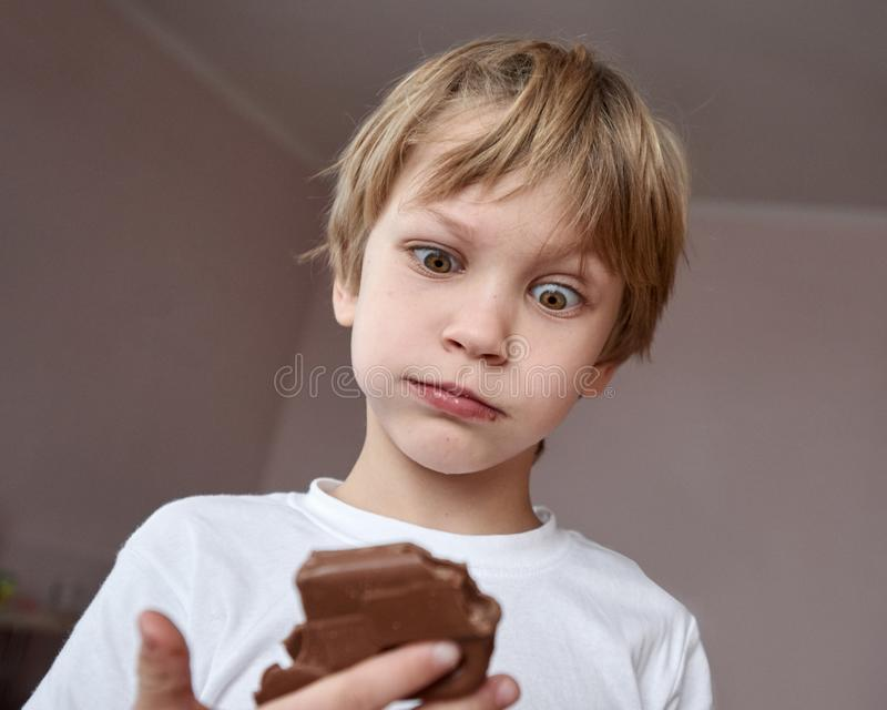 Funny boy with chocolate stock photography