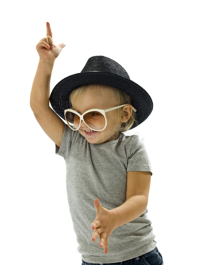 Funny boy dancing. With a hat and glasses royalty free stock photos