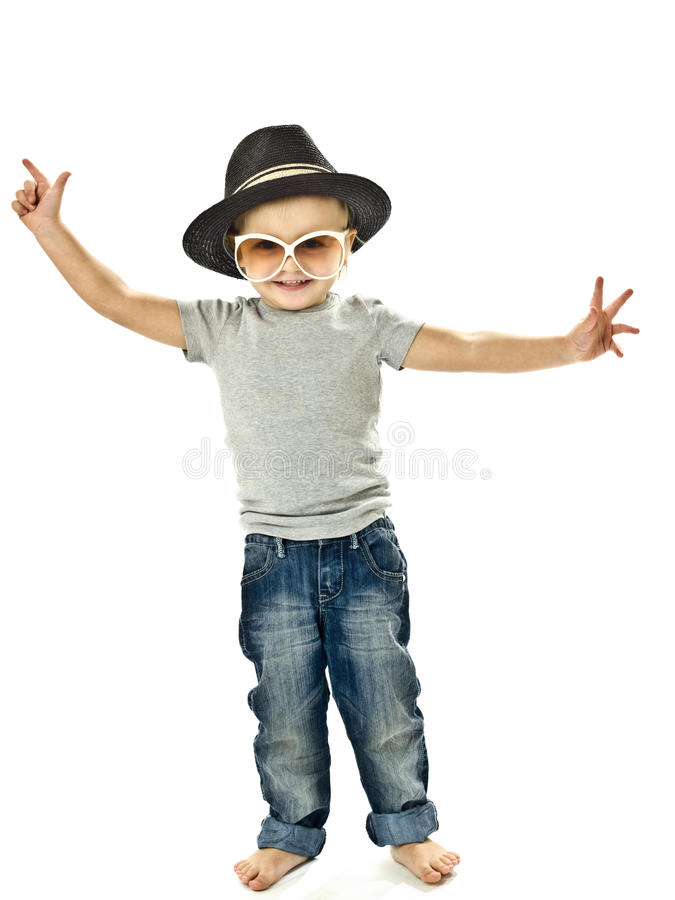Funny boy dancing with a hat and glasses. Little boy dancing with a hat and glasses stock photos