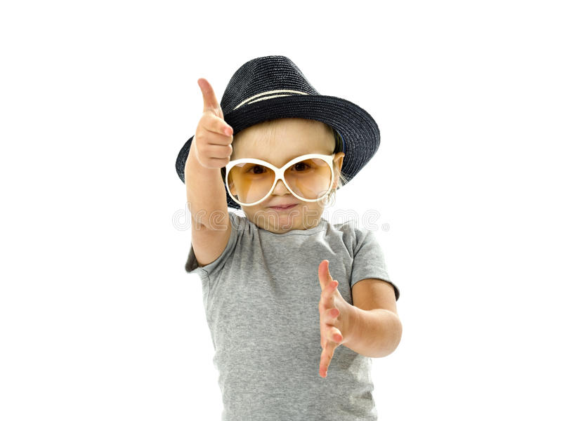 Funny boy dancing with a hat and glasses. Funny boy dancing with black hat and glasses stock image