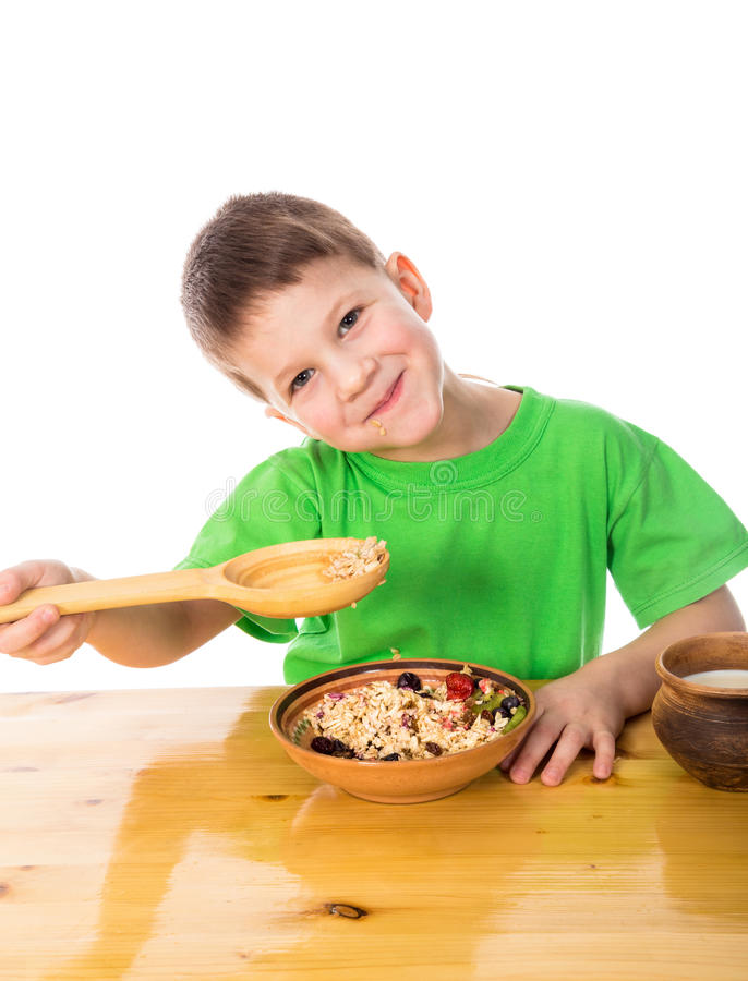 Funny boy eating oatmeal royalty free stock images