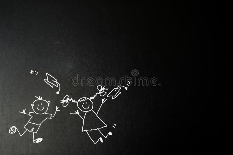 Funny boy and girl at graduation card. Funny boy and girl at graduation party, tickman children drawing with chalk on blackboard with copy space for message stock photography