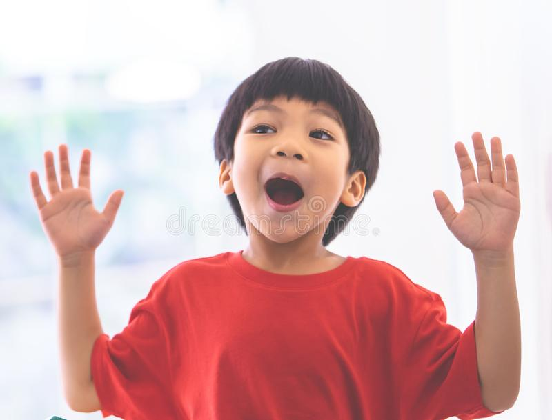 Funny boy in hand up screaming at camera and shocked stock photo
