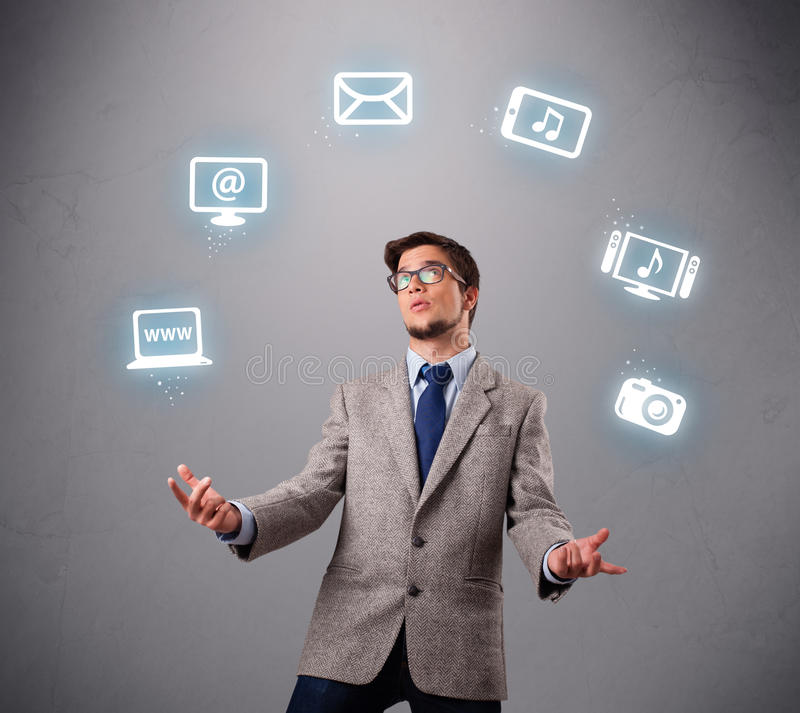Download Funny Boy Juggling With Electronic Devices Icons Stock Image - Image: 28063151