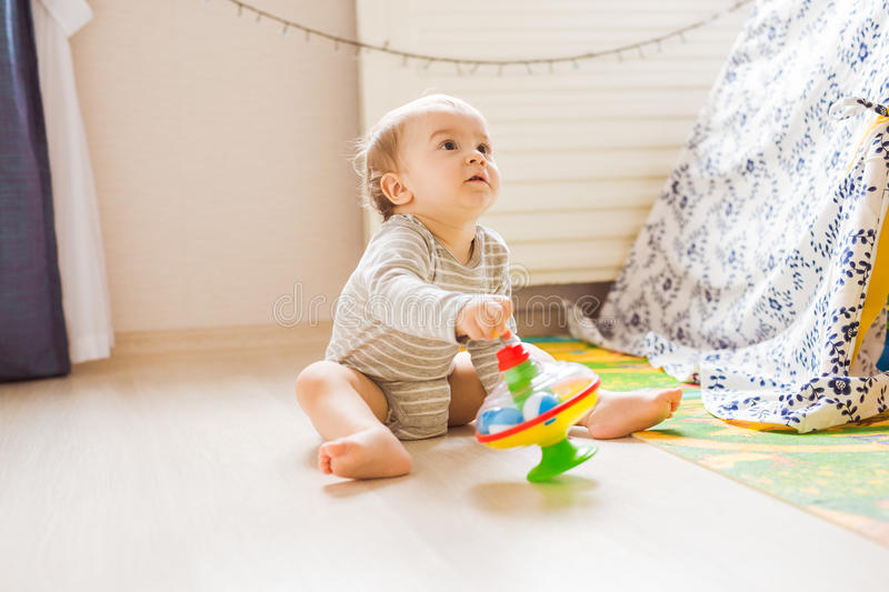 Funny boy kid playing with toy. Funny baby boy kid playing with toy stock photo
