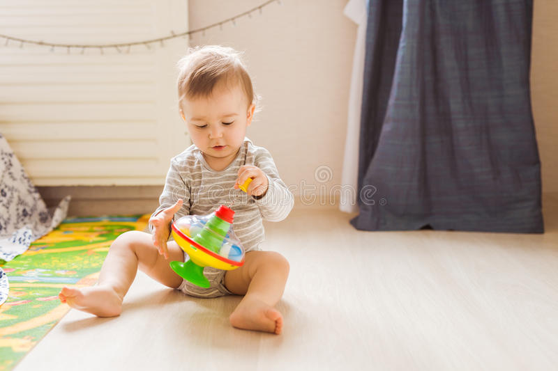 Funny boy kid playing with toy. Funny baby boy kid playing with toy royalty free stock image