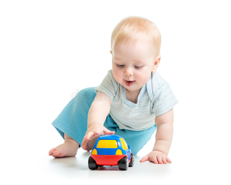 Funny boy kid playing with toy car. Funny child kid playing with toy car royalty free stock images
