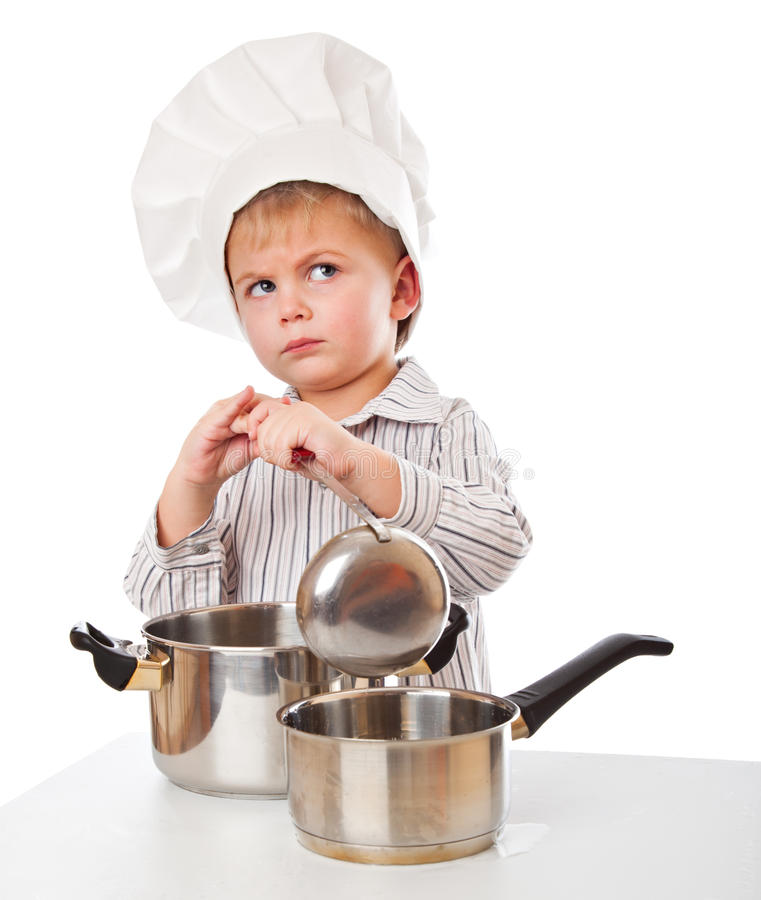 A Funny Boy Is Portraying A Cook Royalty Free Stock Photo