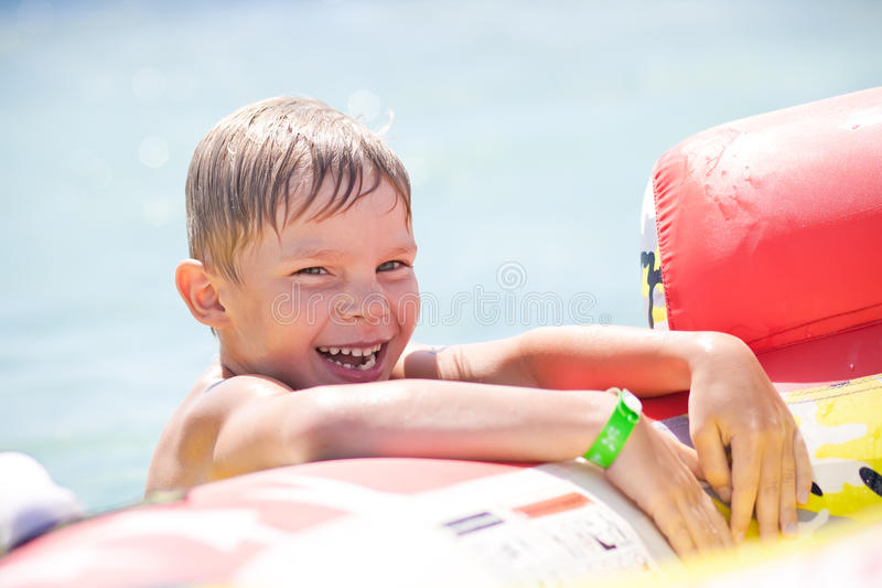 Funny boy on sea stock image