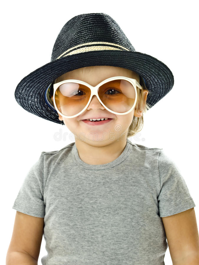 Funny boy smiling. With a hat and glasses royalty free stock photos