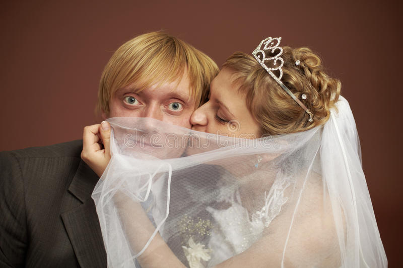 Funny bride and groom. Were closed veil royalty free stock images