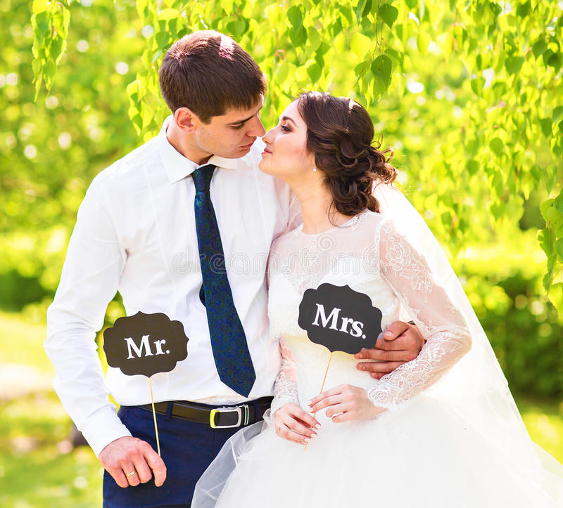 Funny Bride And Groom With Mr And Mrs Signs. Happy Wedding
