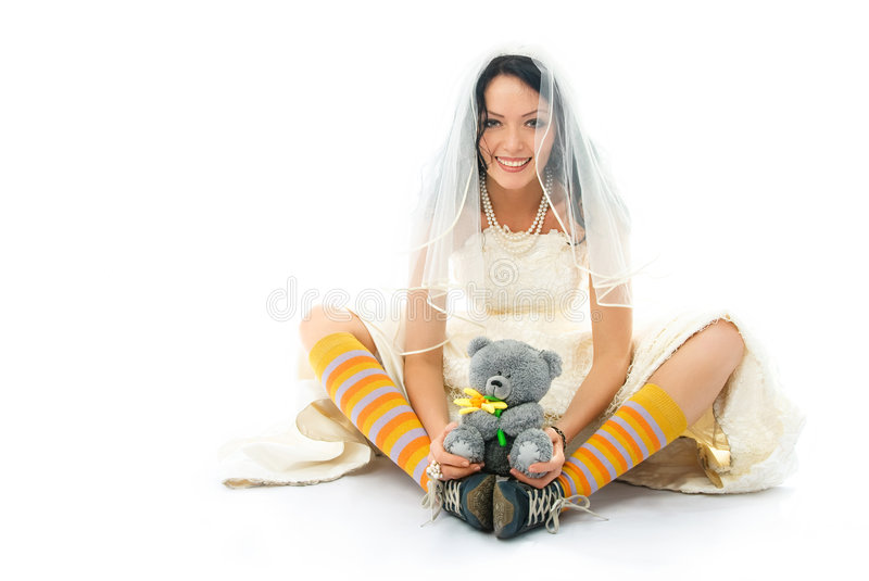 Download Funny Bride Wearing Sporting Shoes With A Toy Stock Photo - Image: 8153532
