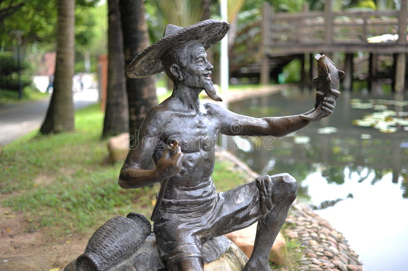 A funny bronze statue. This is a normal bronze statue. It's nobody. But it's quite funny when you see it at first glance since it looks like it's taking selfie royalty free stock photos