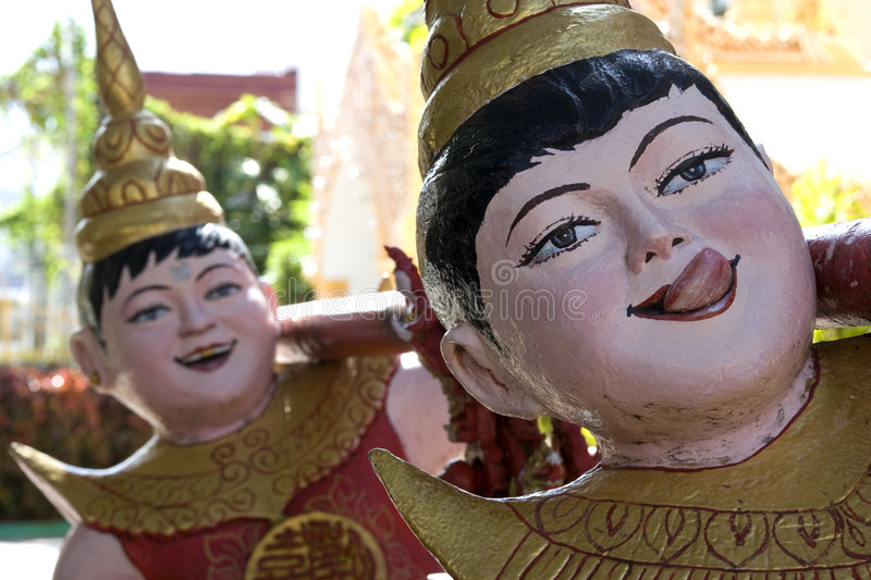 Funny Buddhist Temple Statues. At Dhammikarama Burmese Temple located at UNESCO's World Heritage site, George Town, Penang, Malaysia stock photo