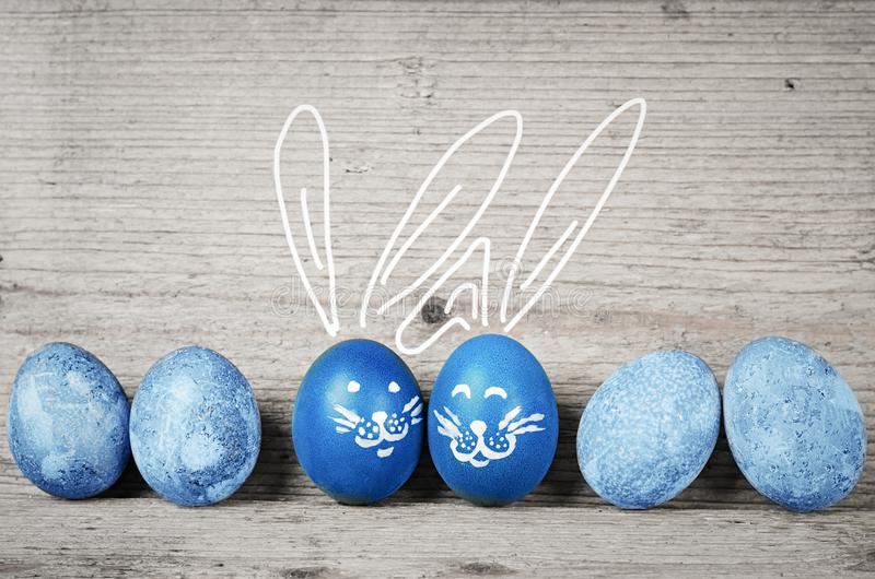 Funny bunnies easter eggs. Cute holidays decorations royalty free stock images