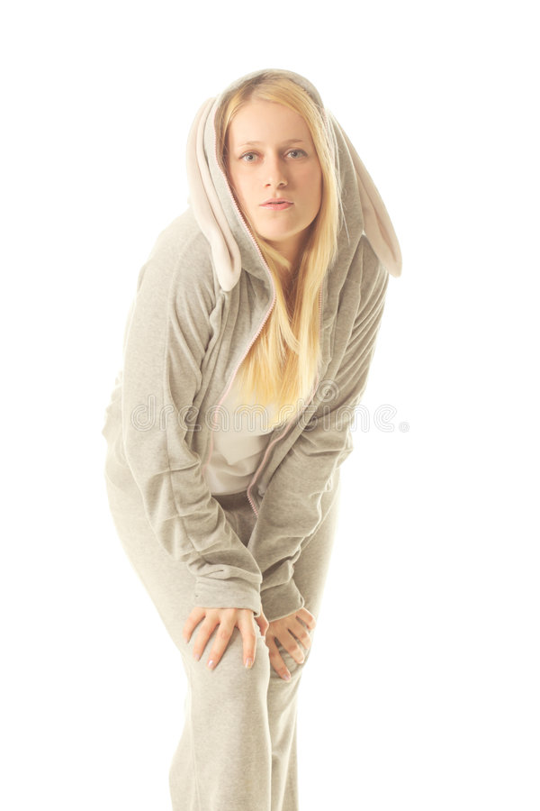 Funny bunny. Funny girl in bunny suit over white background royalty free stock image