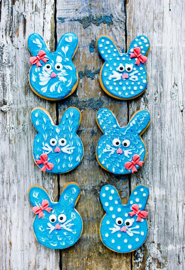 Funny bunny cookies, homemade gingerbread biscuits shaped rabbits. In blue glaze for Easter royalty free stock photos