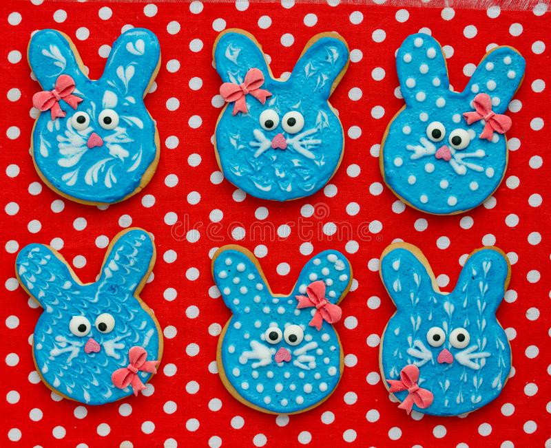 Funny bunny cookies, homemade gingerbread biscuits shaped rabbits for Easter. Funny bunny cookies, homemade gingerbread biscuits shaped rabbits in blue glaze for stock image