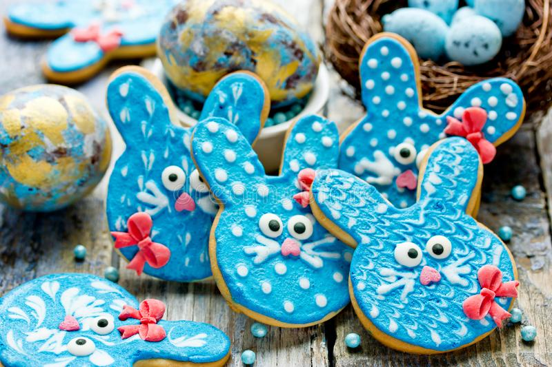 Funny bunny cookies, homemade gingerbread biscuits shaped rabbits for Easter. Funny bunny cookies, homemade gingerbread biscuits shaped rabbits in blue glaze for stock images