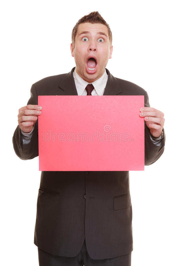 Funny business man holding sign red blank. Nerdy business man or goofy student guy holding sign red blank copy space for text. Funny facial expression. isolated royalty free stock image