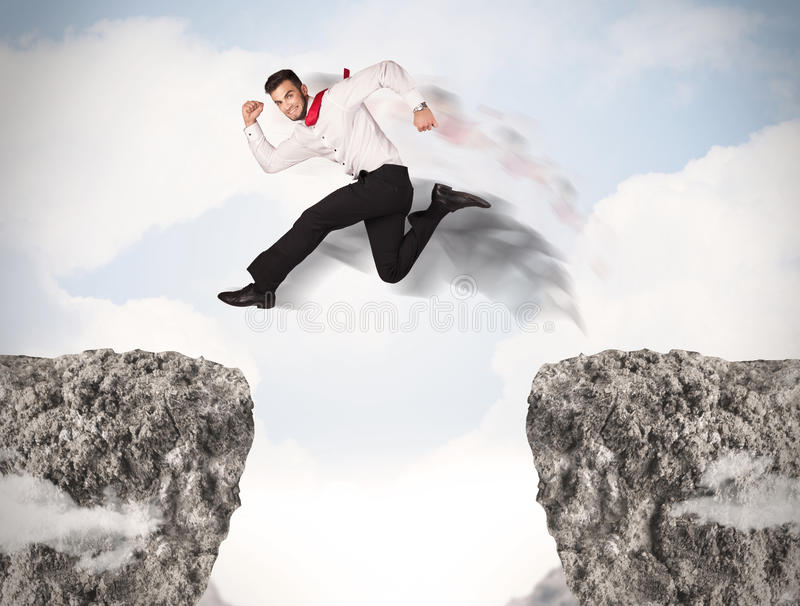 Funny business man jumping over rocks with gap. Concept royalty free stock photos
