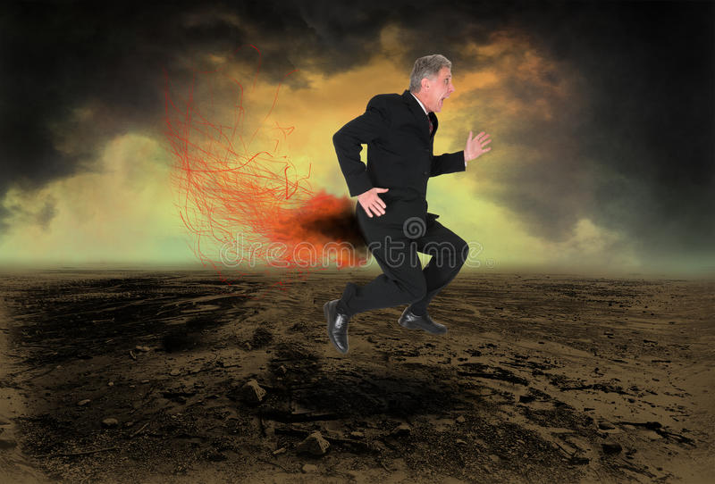 Funny Business Man Pants Fire. A fun and funny business image with a businessman running in pain because his pants are on fire. Liar! Liar! Concept for sales stock photography