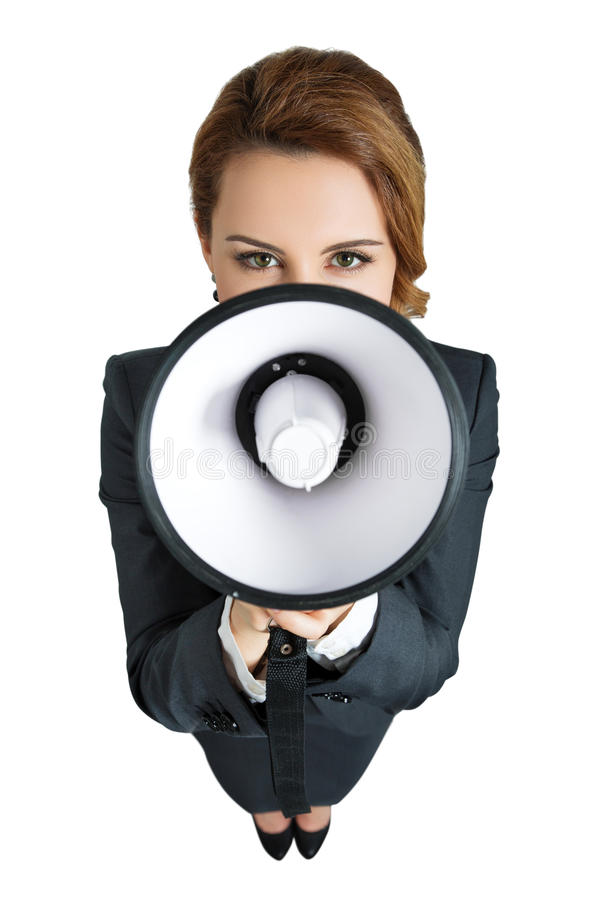 Funny business woman shouting with a megaphone stock photography