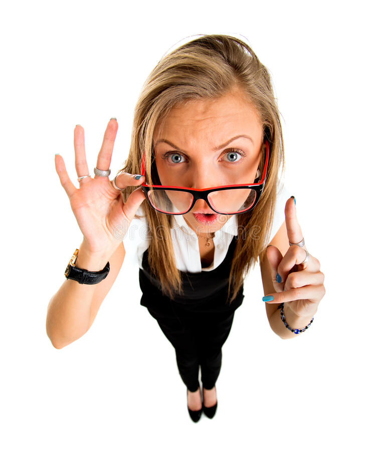 Funny businessl girl pointing up, fish eye lens portrait. royalty free stock image