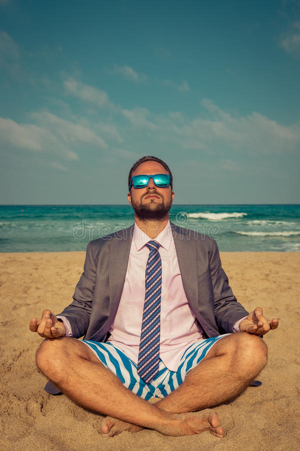 Funny businessman on the beach stock images