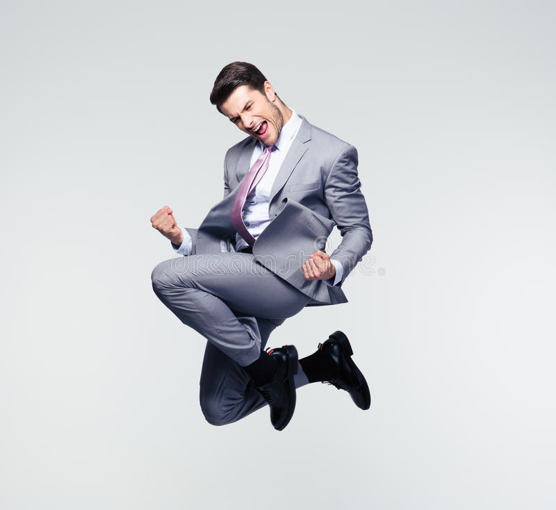 Funny businessman jumping in air stock image