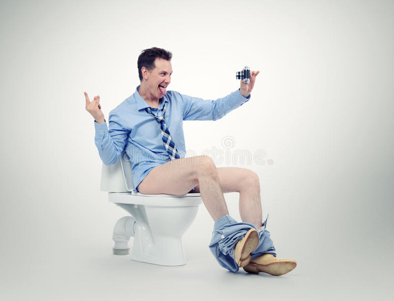 Funny businessman photographing himself in the toilet stock image
