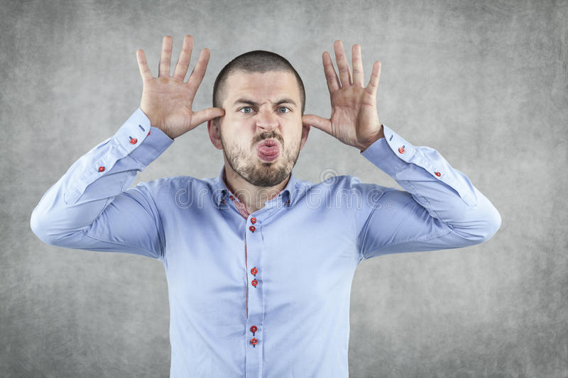 Funny businessman playing on the nerves of the boss. Funny business man playing on the nerves of the boss royalty free stock image