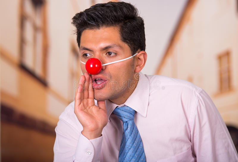 Funny businessman with red plastic nose royalty free stock photos