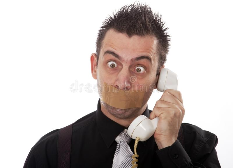 Funny businessman with tape on his mouth stock photos