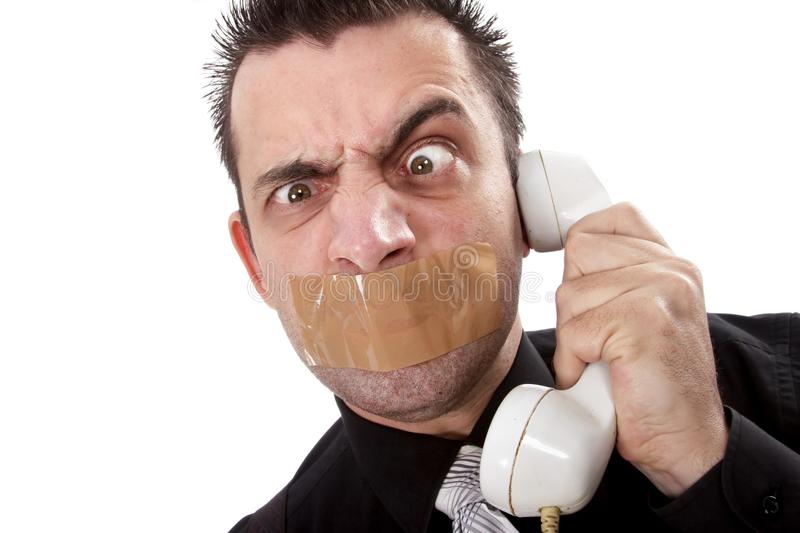 Funny businessman with tape on his mouth royalty free stock photos