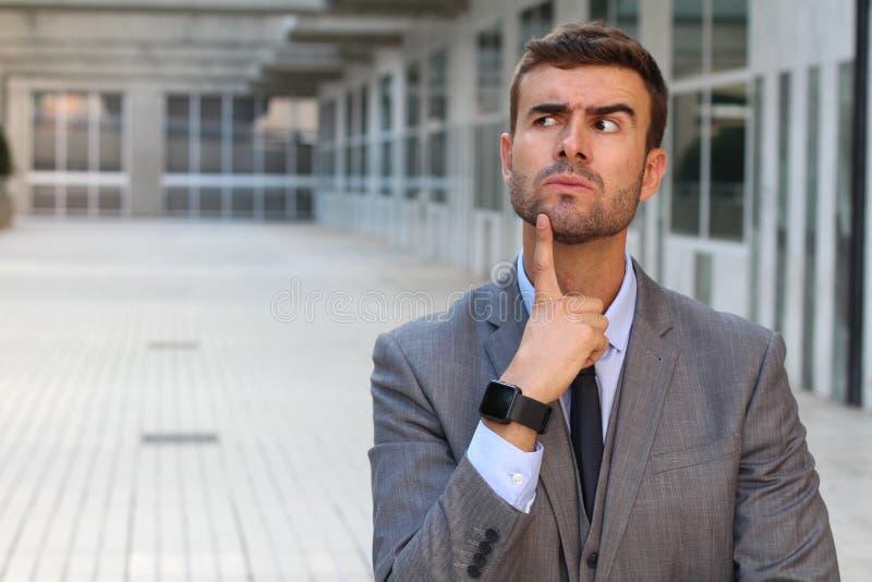 Funny businessman thinking really hard royalty free stock photos