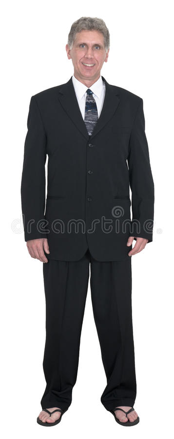 Funny Businessman Wear Suit, Tie, Flip Flops, Isolated. A funny middle aged businessman wearing a suit and tie and flip flops. The man is smiling, it must be stock photos