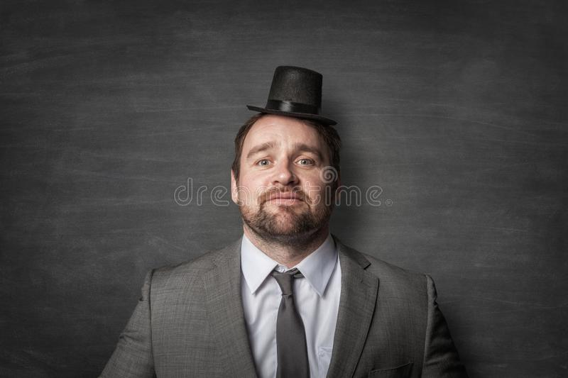 Funny businessman wearing a cylinder hat stock photography