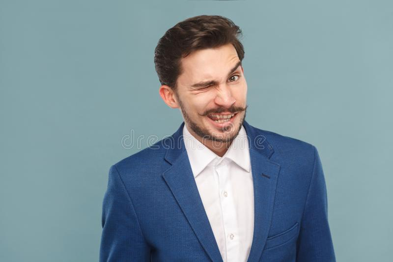 Funny businessman wink and flirt at camera stock photo