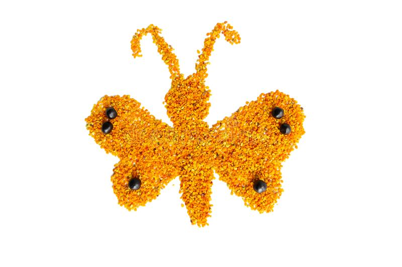 A funny butterfly made from pile fresh pollen isolated on white background royalty free stock images