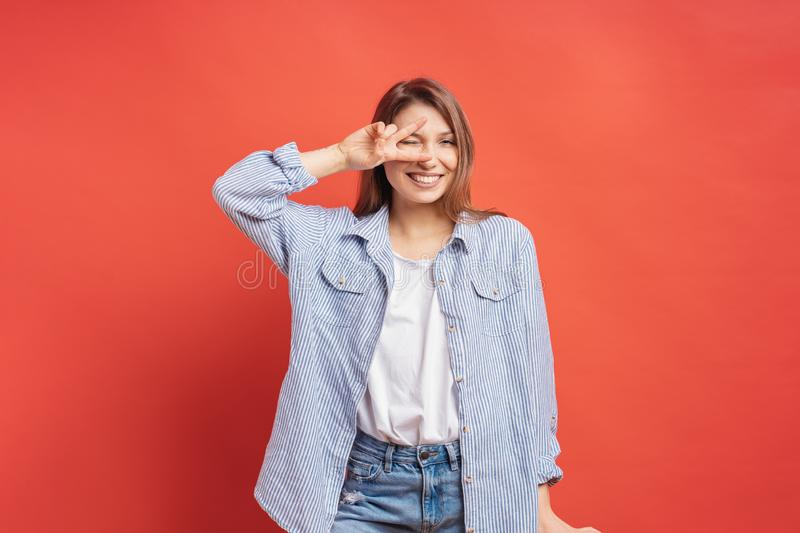 Funny, carefree girl having fun isolated on a red background royalty free stock photo